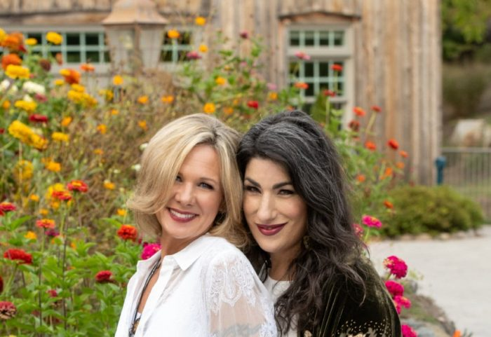 Lisa Gercie and Lisa Linder standing in front of a garden.